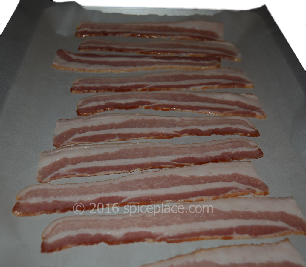 Bacon on half-sheet pan lined with parchment paper