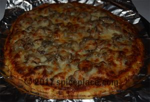 Picture of a cooked pizza made using cauliflower as crust